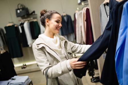 buying: Beautiful shopaholic woman buying clothes