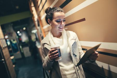 after work: Brunette woman using tablet after work