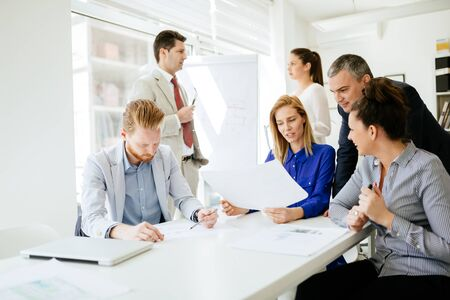 Succeful business partners brainstorming in office