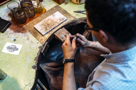 creating: Jeweler creating jewelry