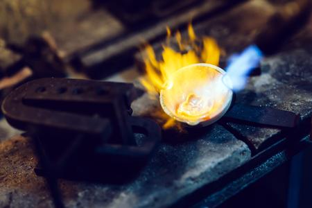 Goldsmith melting metal to liquid state