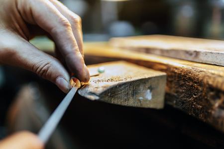 Jeweler welding gold the traditional way Foto de archivo
