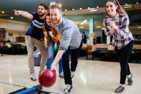 Friends bowling and enjoying moments together Stock Photo