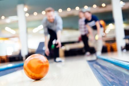 Friends enjoying recreational  bowling at club