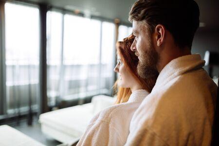 Romantic couple hugging in bathrobe