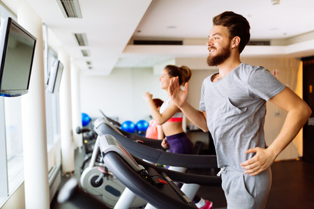 cardio workout: People running on treadmill in gym doing cardio workout Stock Photo