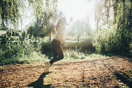 staying fit: Fit beautiful woman jogging in park and staying healthy