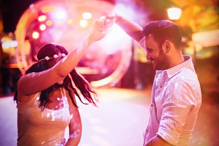 Happy couple dancing in club Stock Photo