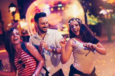 People clubbing and dancing at party during festival Stock Photo