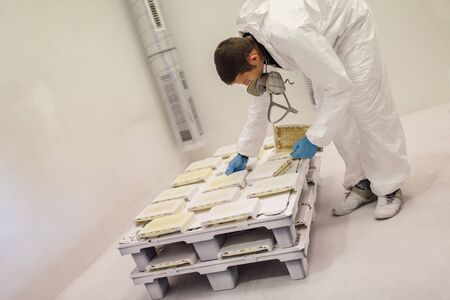 protective clothing: Painter using airbrush to paint wearing protective clothing Stock Photo