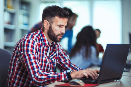 Programmer working in a software developing company office Banco de Imagens