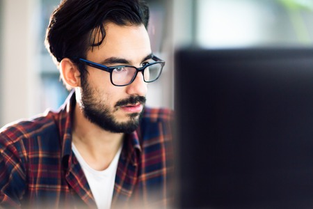 developement: Programmer working at software developement company office Stock Photo