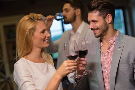 degustating: Wine tasting event with people degustating wines