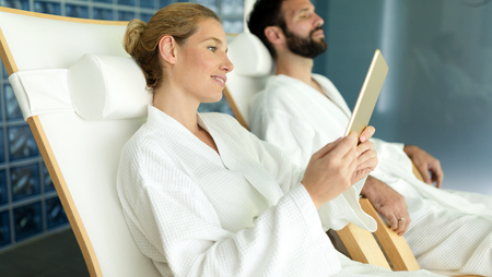 Couple relaxing at spa resort  in gowns on massage beds