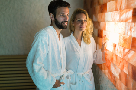 Couple enjoying salt room therapy at spa resort Stockfoto