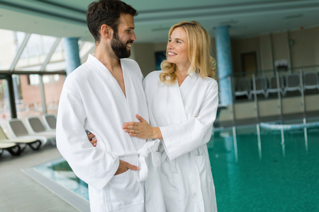 Happy coupleenjoying treatments and relaxing at wellness spa center