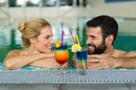 Happy married couple relaxing at wellness spa resort Stock Photo