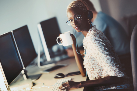 Programmer working at software developement company office Stock Photo