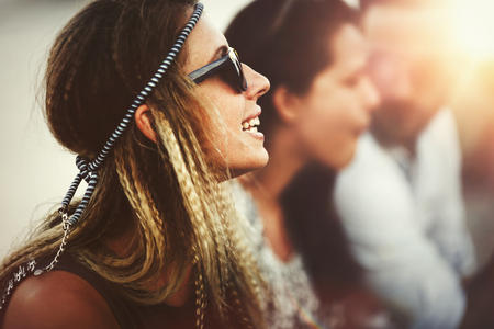 Blond afro woman enjoying summer festival and having fun