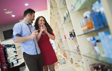 Couple testing perfumes and fragrances at cosmetics store Stok Fotoğraf
