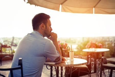 Sad single romantic man waiting for his date Stock Photo