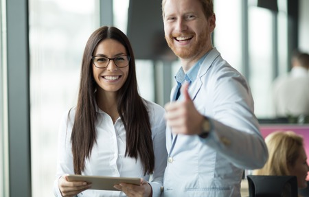 Happy and confident colleagues looking for you at expanding company Stock Photo