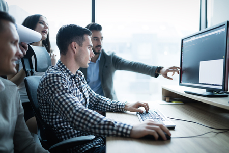Business collaboration in office by IT colleagues and programmers