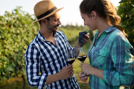People sampling and tasting wines in winegrowers  vineyard