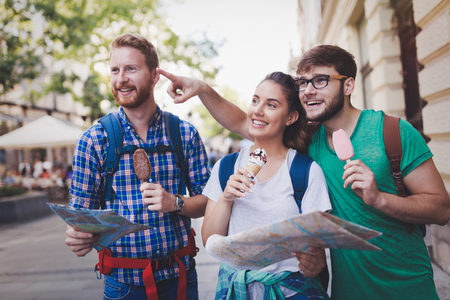 Tourist group of  friends discovering city on foot and travelling Stock Photo