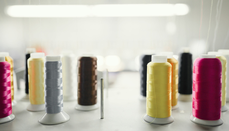 Colorful thread spools in fabric industry Stock Photo
