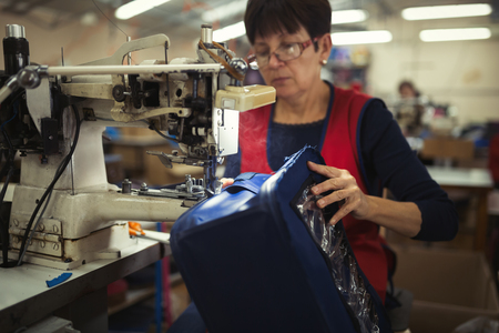 Woman working in sewing industry on machine