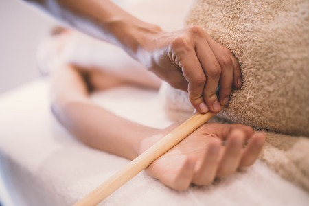 Hand and palm massage by therapist at spa resort