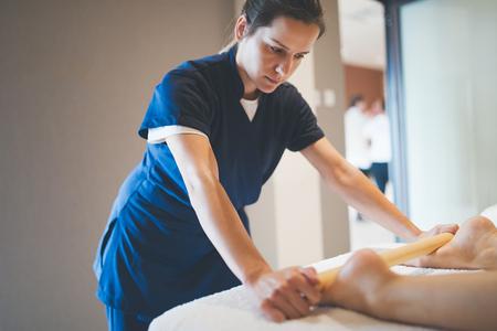 Cliend enjoying massage treatment given by masseur Stock Photo
