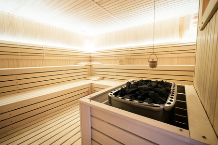 Beautiful sauna interior with heater  and stones Stock Photo