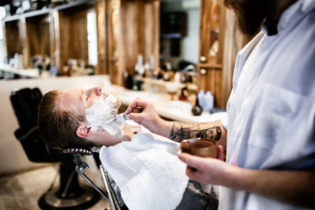 haircut: Retro shaving with foam in barber shop Stock Photo