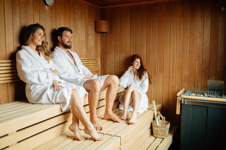 People pursuing healthy lifestyles relaxing in sauna 免版税图像