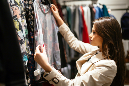 consumerism: Beautiful businesswoman buying clothes Stock Photo