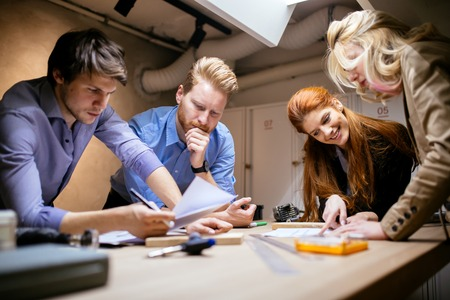 architect drawing: Creative workers designing and planing together in workshop Stock Photo