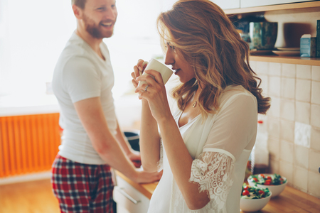 Romantic couple in love speding time together in kitchen