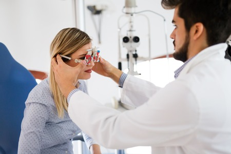 Female patient in ophthalmology clinic for diopter detection Stock Photo