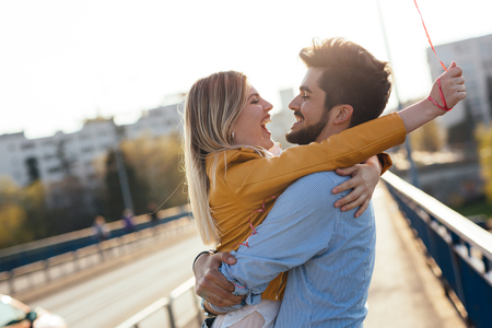 young couple in love hugging dating and kissing outdoor Stock Photo