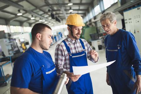 Mechanical and metal industry engineers working in factory Stockfoto