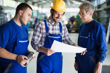 Team Of Engineers Having Discussion In Metal Factory
