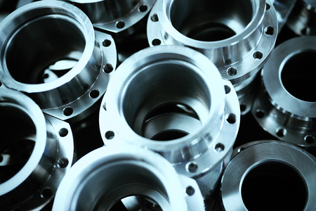 Industrial background from metal parts produced in metal industry factory