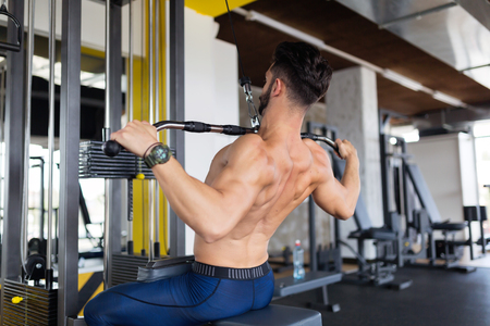 Handsome young man working on lat machine Stockfoto