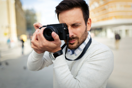 Photographer taking photos outside with camera Stock Photo