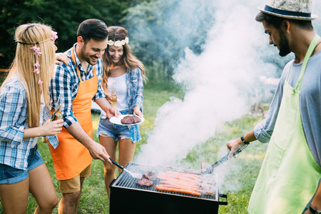 Friends spending time in nature and having barbecue Stok Fotoğraf