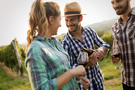 People sampling and tasting wines in vineyard Stok Fotoğraf - 82752899