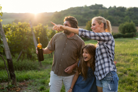 Winegrower family tasting wine Stock Photo