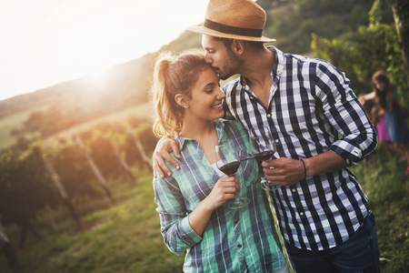 Couple in love working at winemaker vineyard Reklamní fotografie